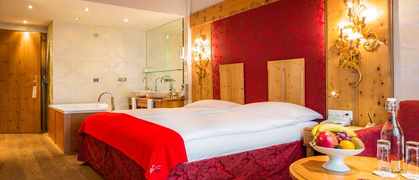 Hotel Ferienart Resort & Spa, Saas-Fee, Switzerland - Double bedroom with bath.jpg